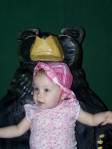 Sophia at the zoo in a bear chair.