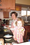 "Sophia ""helping"" me cook in our new matching aprons"